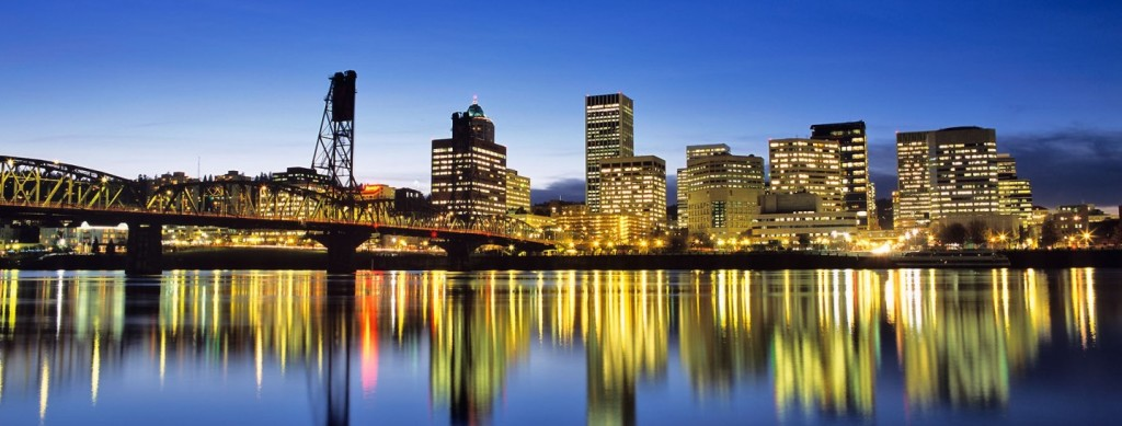 Skyline of Portland Oregon reflects in the Willamette River at dusk